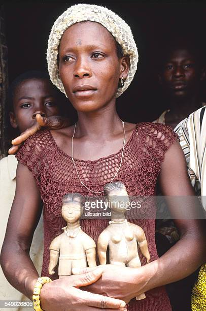 Ewe woman with twin dolls in the Volta region in Ghana