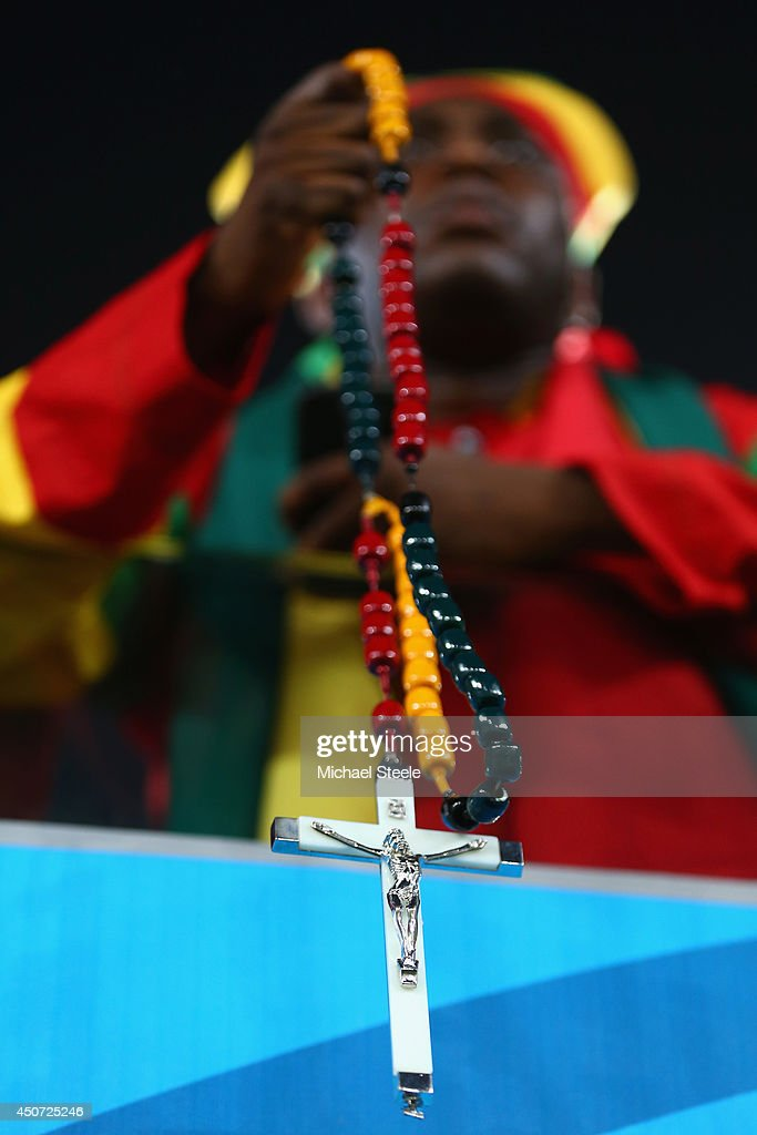 A Ghana fan holds a rosary prior to the 2014 FIFA World Cup Brazil Group G match between Ghana and the United States at Estadio das Dunas on June 16, 2014 in Natal, Brazil.