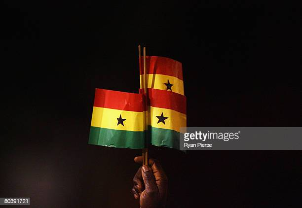 Ghana fan holds up Ghanaian flags during the international friendly match between Ghana and Mexico at Craven Cottage on March 26 2008 in London...