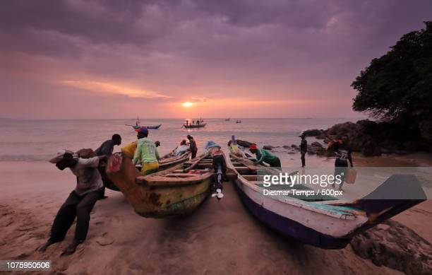 Ghana, fishing boats at sunrise