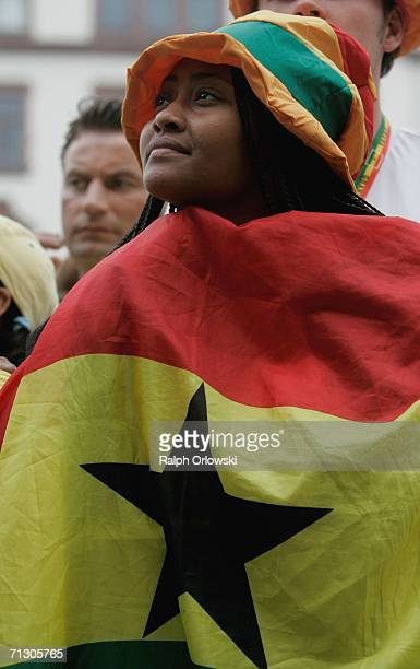 Ghana football fan watches a broadcast of the World Cup match of her team on June 27, 2006 in Dortmund, Germany. Brazil played against Ghana in their...
