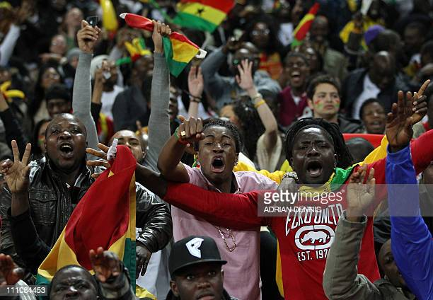 Ghana football fans celebrate Asomoah Gyan's equaliser against England in an International friendly football match at Wembley Stadium in London on...