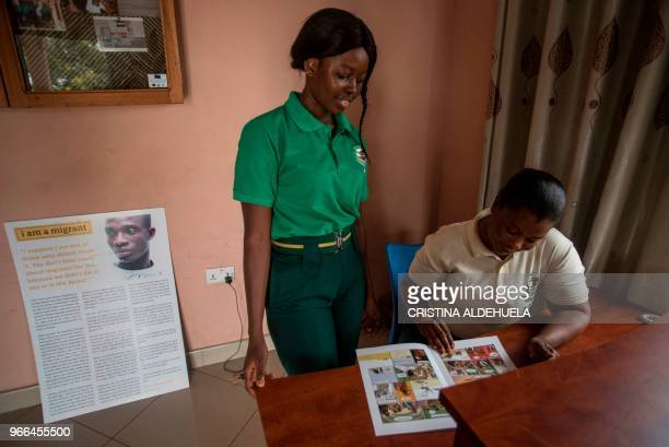 Ghana immigration officers take a look at a comic that illustrates the dangers of illegal migration at the Migration Information Centre in Sunyani...