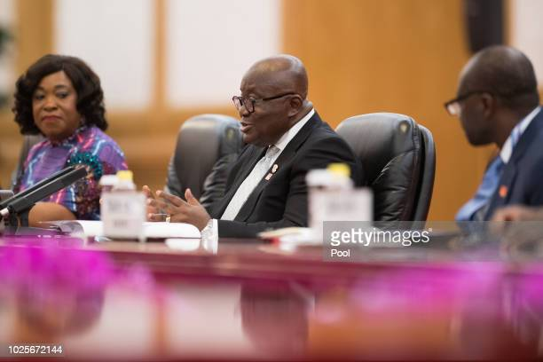 Ghana President Nana AkufoAddo speaks to China's President Xi Jinping during a meeting at the Great Hall of the People on September 1 2018 AkufoAddo...