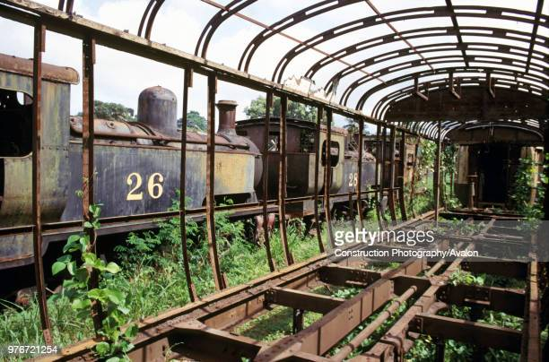 Ghana Railway's 080Ts built in Britain by Hunslet of Leeds lie abandoned alongside the skeletal form of coaching stock at Location Works in 1985