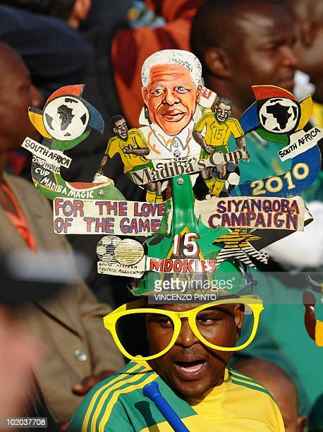 A Ghana supporter wearing a makarapa cheers prior to the start of the Group D first round 2010 World Cup football match Serbia vs Ghana on June 13...