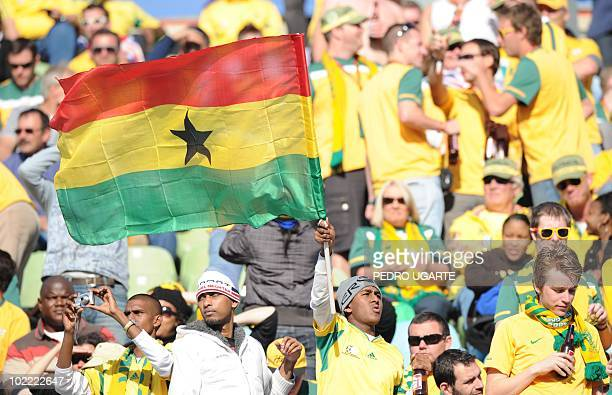 Ghana supporters with a Ghanaian flag cheer prior to the start of the Group D first round 2010 World Cup football match Ghana vs Australia on June 19...