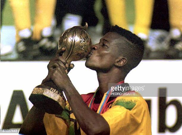Ghana team captain Emmanuel Bentil kisses the trophy after winning the first final game of the Sub17 soccer tournament in Guayaquil Ecuador 20 August...