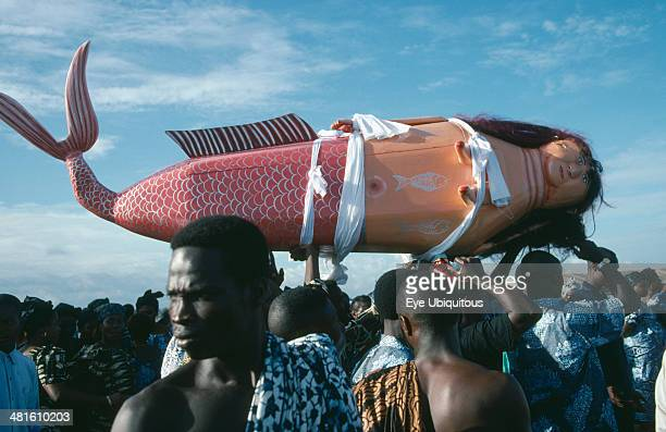 Ghana Teshie Coffin made and painted to resemble a mermaid for Ga tribal priestess of sea god carried by funeral guests