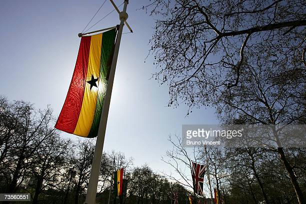 Ghanaian and United Kingdom flags fly along The Mall for the state visit of President of Ghana John Kufuor on March 13 2007 in London England The...
