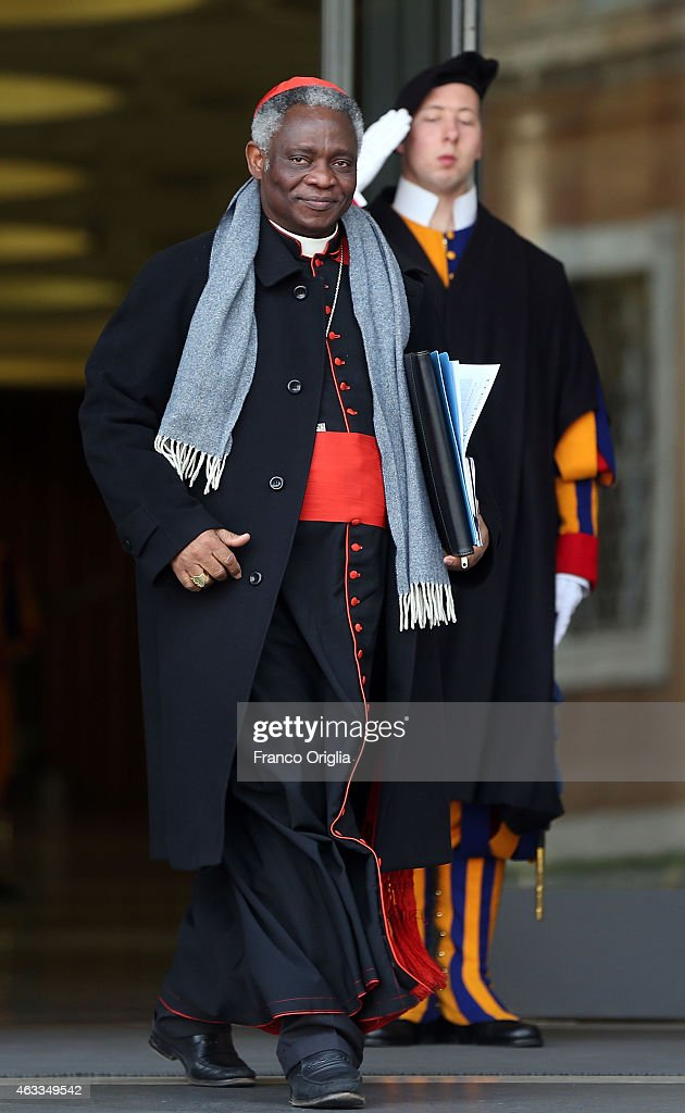 Ghanaian cardinal Peter Kodwo Appiah Turkson leaves the Synod Hall at the end of the Extraordinary Consistory for the creation of new cardinals on February 13, 2015 in Vatican City, Vatican. Reform of the Curia, is at the centre of the Extraordinary Consistory which included the 20 prelates who will be created Cardinals on Saturday.