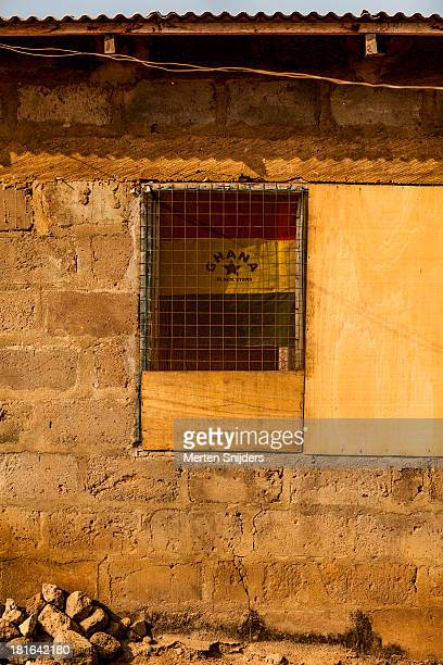 ghanaian flag in primitive window - ghanaian flag stock photos and pictures
