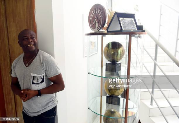 Ghanaian football legend Abedi Ayew known professionally as Abedi Pele speaks about his career as he stands by a glass case displaying all his...