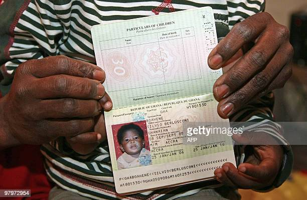 Ghanaian immigrant Anthony Boahene a 36yearold metal worker living in Italy shows the passport of his son named Silvio Berlusconi in his home in...