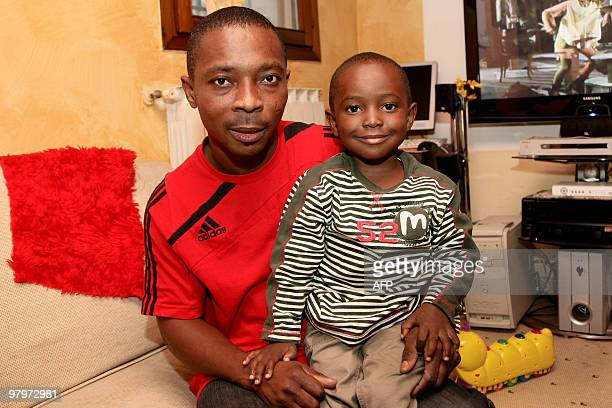 Ghanaian immigrant Anthony Boahene a 36yearold metal worker poses with his son named Silvio Berlusconi in his home in Modena on March 23 2010 'I like...