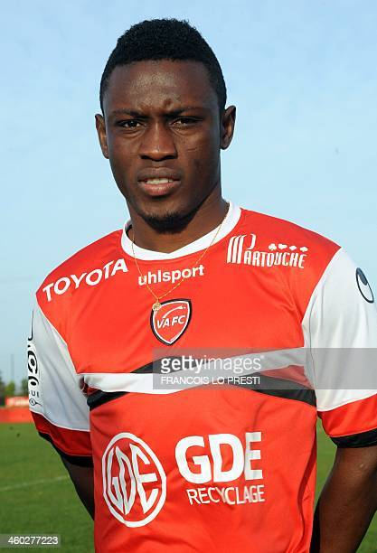 Ghanaian international forward Abdul Majeed Waris poses with his new jersey after a press conference on January 3 2014 in Valenciennes northern...