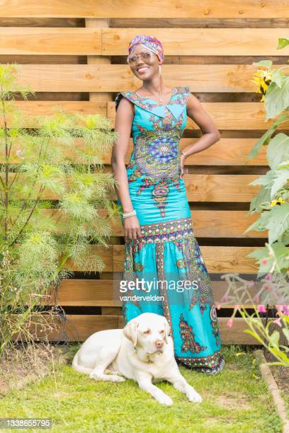 ghanaian lady in her garden - sleeveless dress stock pictures, royalty-free photos & images