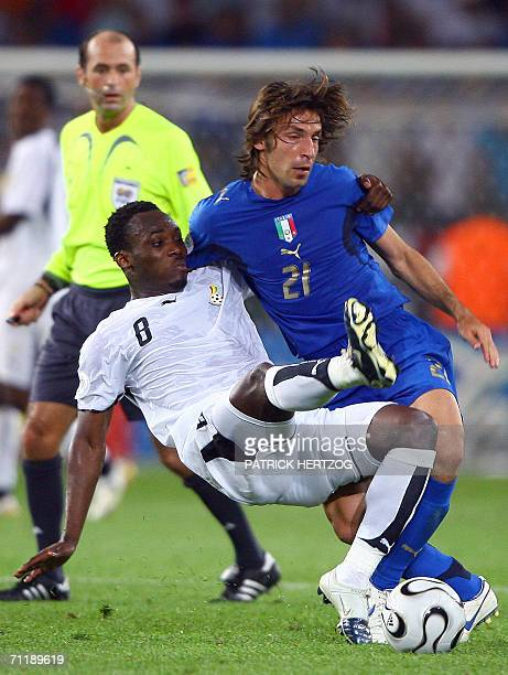 Ghanaian midfielder Michael Essien vies with Italian midfielder Andrea Pirlo during the football World Cup 2006 group E football match Italy vs...