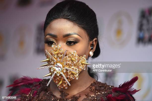 Ghanaian model Nana Akua Addo poses on the red carpet during the All Africa Music Awards in Lagos on November 12 2017 / AFP PHOTO / PIUS UTOMI EKPEI