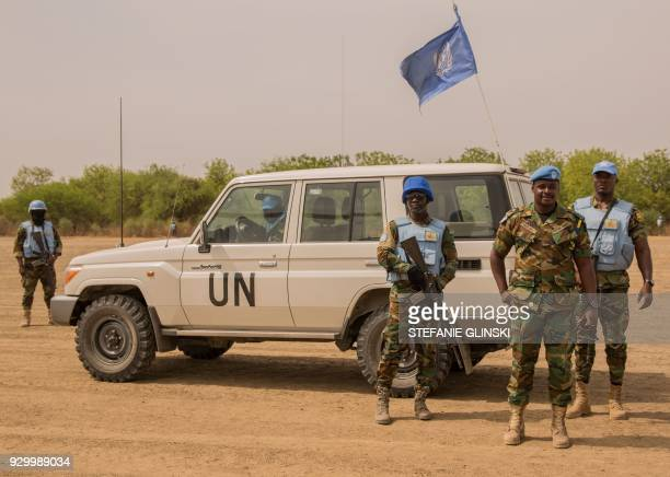 Ghanaian peacekeepers of the United Nations Mission in South Sudan patrol on March 7 2018 in Leer where famine has been declared since February 2017...