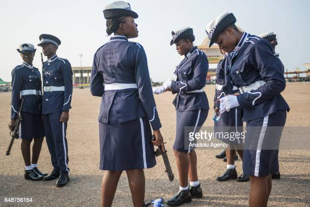 Ghanaian police women get prepared ahead of the celebrations held for the 60th anniversary of Ghana's Independence at the Independence Square in...