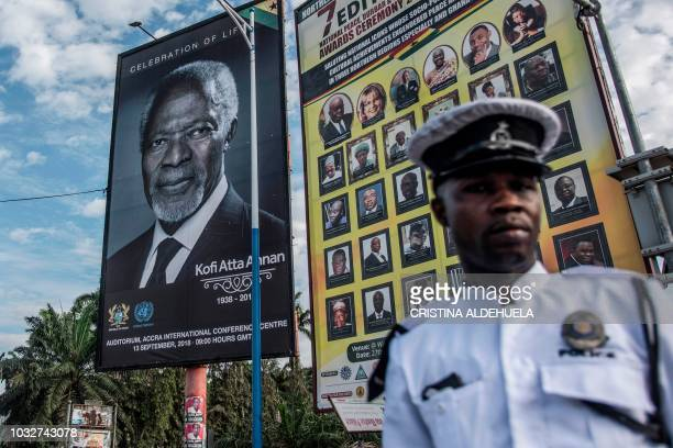 A Ghanaian policeman stands next to a portrait of Kofi Annan a Ghanaian diplomat and former Secretary General of United Nations who died on August 18...