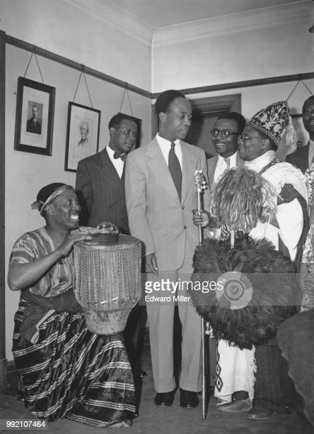 Ghanaian politician Kwame Nkrumah , leader of the United Gold Coast Convention, is greeted at Conway Hall in London by drummer Alf Payne and Chief...
