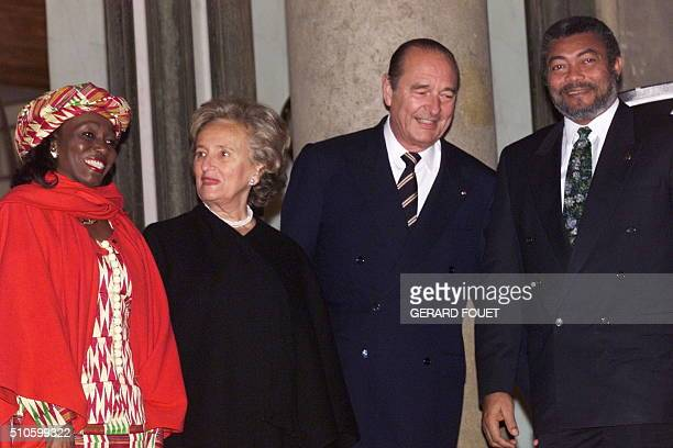 Ghanaian President Jerry Rawlings and his wife are welcomed by French President Jacques Chirac and his wife Bernadette at the Elysee Palace for the...