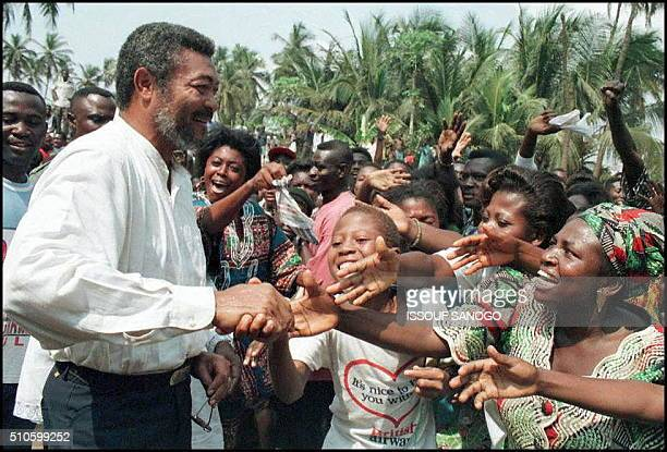 Ghanaian President Jerry Rawlings is cheered by supporters after he cast his vote in his country presidential and parliamentary elections in Accra 07...