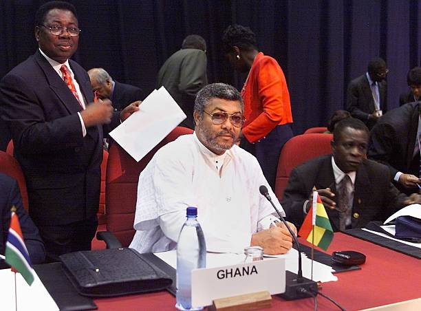 Ghanaian President Jerry Rawlings is surounded by unidentified aides before the start of an executive session at the Commonwealth heads of government...