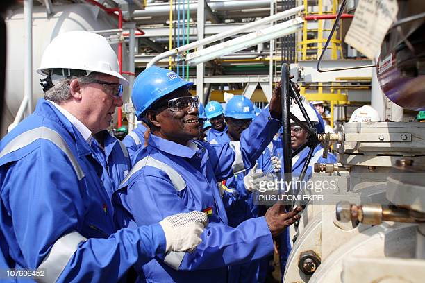 Ghanaian President John Atta Mills turns the valve to flag off first oil production at FPSO Kwame Nkrumah oil rig at the Jubilee field in Takoradi...