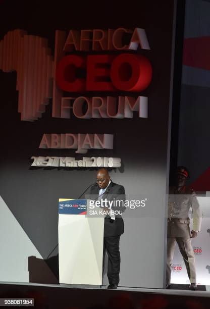 Ghanaian President Nana AkufoAddo delivers a speech next to his aidedecamp during the opening session of the AFRICA CEO FORUM in Abidjan on March 26...