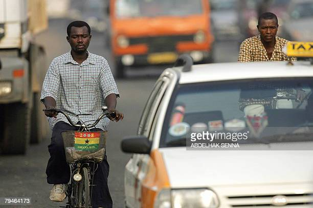 A Ghanaian rides bicycle decorated with a Ghanaian flag in Accra 01 February 2008 during the African Cup of Nations football championship Ghana will...
