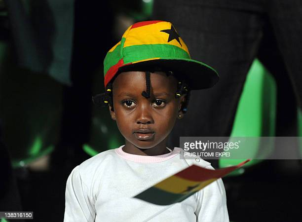 A Ghanaian supporter holds a flag on February 5 2012 during an Africa Cup of Nations quarterfinal match against Tunisia at the Franceville stadium...