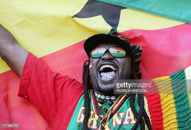 Ghanaian supporters cheer prior the football World Cup 2006 group E football match Italy vs Ghana, 12 June 2006 at Hannover stadium. AFP PHOTO /...