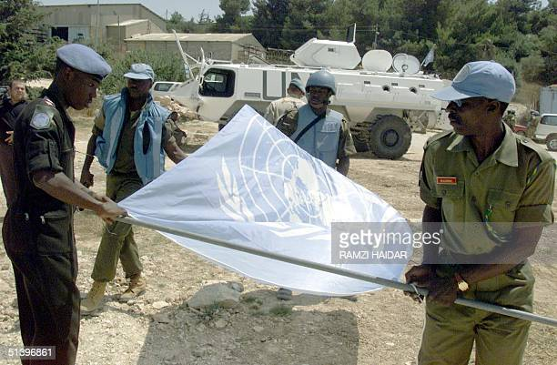 Ghanaian United Nations soldiers put up UN flag as they take position 28 July 2000 in Manara south Lebanon The UN said that it started to deploy in...