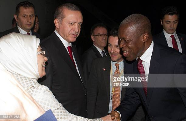 Ghanaian Vice President Kwesi Bekoe AmissahArthur shakes hand with Turkish President Recep Tayyip Erdogan's wife as he stands beside them in Accra on...