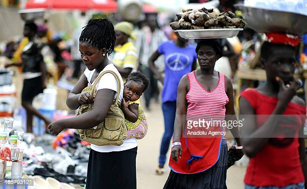 Ghanaian woman carries her child on October 132013 in Accra Ghana Unlike other African countries Ghana tends to be more secure and a calm place to...