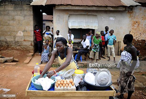 Ghanaian woman cooks a meal on October 132013 in Accra Ghana Unlike other African countries Ghana tends to be more secure and a calm place to live...