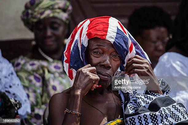 CONTENT] Ghanaian woman the head with the flag of England during the AKWASIDAE traditional festival in which the king of the Ashanti Osei Kofu Tutu...