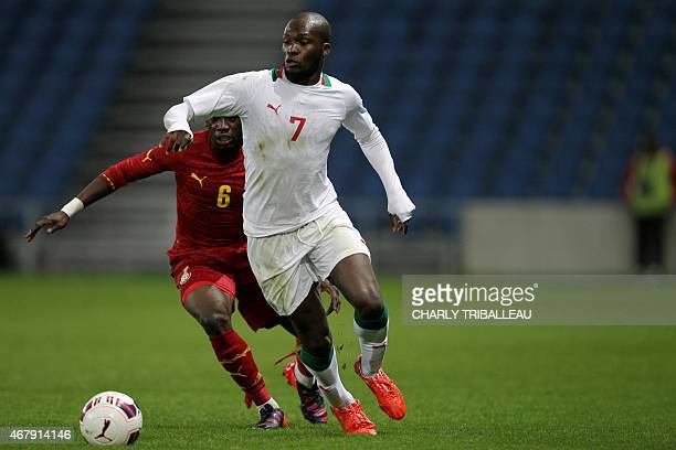 Ghana's Afriyea Acquah vies for the ball with Senegal's Moussa Sow during the International Friendly football match between Senegal and Ghana on...