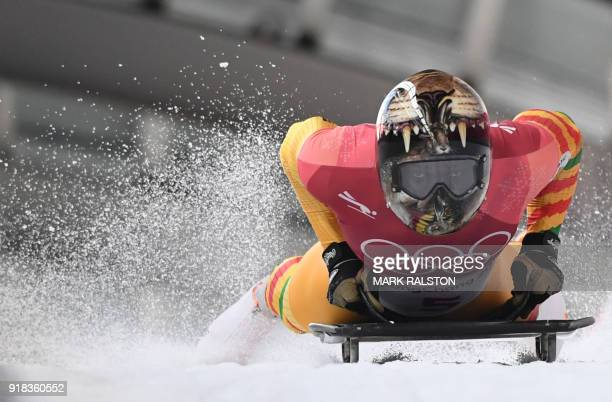 TOPSHOT Ghana's Akwasi Frimpong slows down at the end of the mens's skeleton heat 1 during the Pyeongchang 2018 Winter Olympic Games at the Olympic...