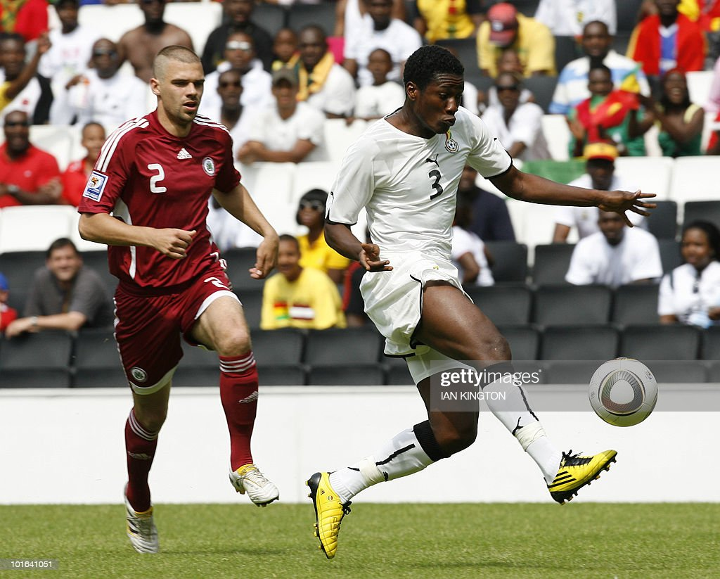 Ghana's Asamoah Gyan (R) controls the ball under pressure from Latvia's Oskars Klava during a pre World Cup 2010 International friendly football match in Milton Keynes on June 5, 2010. AFP PHOTO/Ian Kington