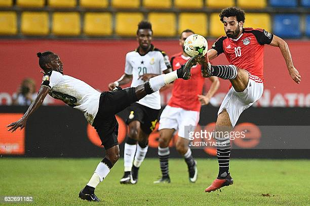 TOPSHOT Ghana's defender Harrison Afful challenges Egypt's forward Mohamed Salah during the 2017 Africa Cup of Nations group D football match between...