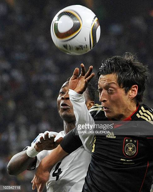 Ghana's defender John Paintsil vies with Germany's midfielder Mesut Oezil during their Group D first round 2010 World Cup football match on June 23...