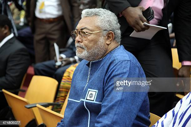 Ghana's former President Jerry Rawlings attends the State of the Nation address at the Parliament on February 25 2014 in Accra Ghana John Dramani...