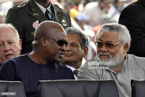 Ghana's former Presidents John Dramani Mahama and Jerry Rawlings talks during the swearingin ceremony of Liberia's presidentelect on January 22 2018...