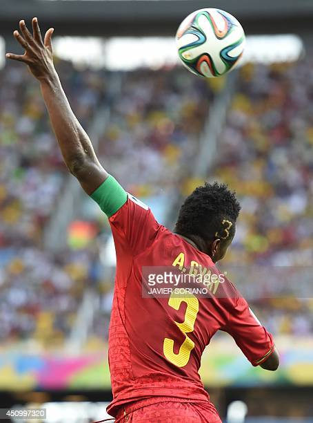 Ghana's forward and captain Asamoah Gyan heads the ball during a Group G football match between Germany and Ghana at the Castelao Stadium in...