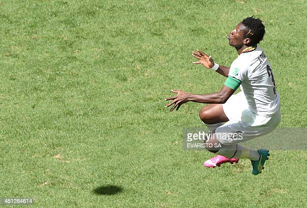 Ghana's forward and captain Asamoah Gyan jumps for the ball during the Group G football match between Portugal and Ghana at the Mane Garrincha...