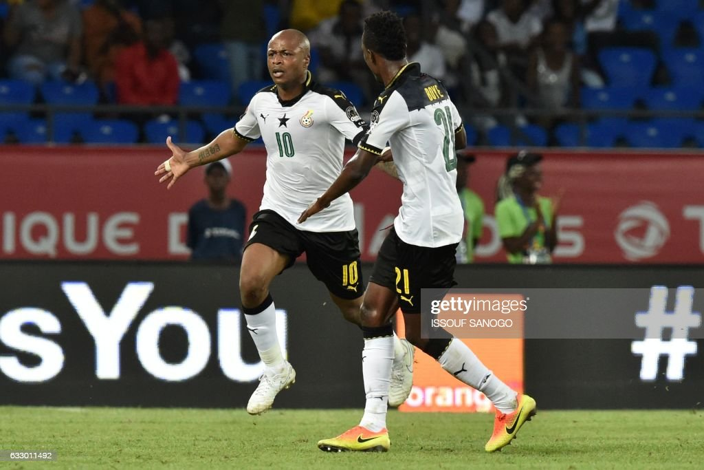 Ghana's forward Andre Ayew (L) celebrates with Ghana's defender John Boye after scoring his team's second goal during the 2017 Africa Cup of Nations quarter-final football match between DR Congo and Ghana in Oyem on January 29, 2017. /